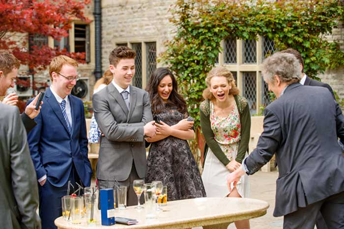 Performing magic outdoors at a wedding