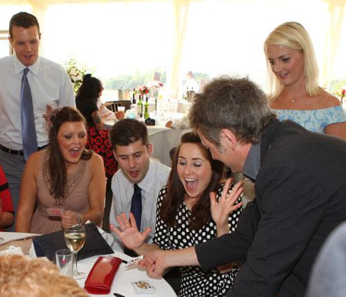 Close up magic at a wedding reception